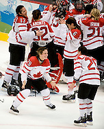 Marie-Philip Poulin, bottom left, and Sarah Vaillancourt celebrate after their 2-0 gold medal victory over Team USA in women's hockey at the 2010 Olympic Winter Games in Vancouver, BC.