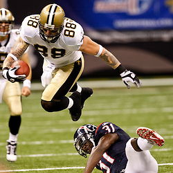 August 21, 2010; New Orleans, LA, USA; New Orleans Saints tight end Jeremy Shockey (88) leaps over Houston Texans safety Bernard Pollard (31)during the first quarter of a preseason game at the Louisiana Superdome. Mandatory Credit: Derick E. Hingle