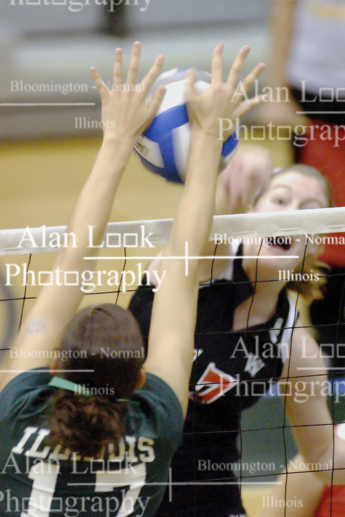 27 October 2006: The 17's do battle, Emilie Walk's hit is blocked by Michele Malinowski. The Bears won the match 3 games to 1. The match between the Washington University Bears and the Illinois Wesleyan Titans took place at Shirk Center on the IWU campus in Bloomington Illinois.<br />