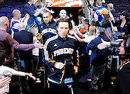 Feb. 17, 2011; Phoenix, AZ, USA; Phoenix Suns guard Steve Nash (13) and teammate forward Grant Hill (33) react during pregame ceremonies against the Dallas Mavericks at the US Airways Center. Mandatory Credit: Jennifer Stewart-US PRESSWIRE