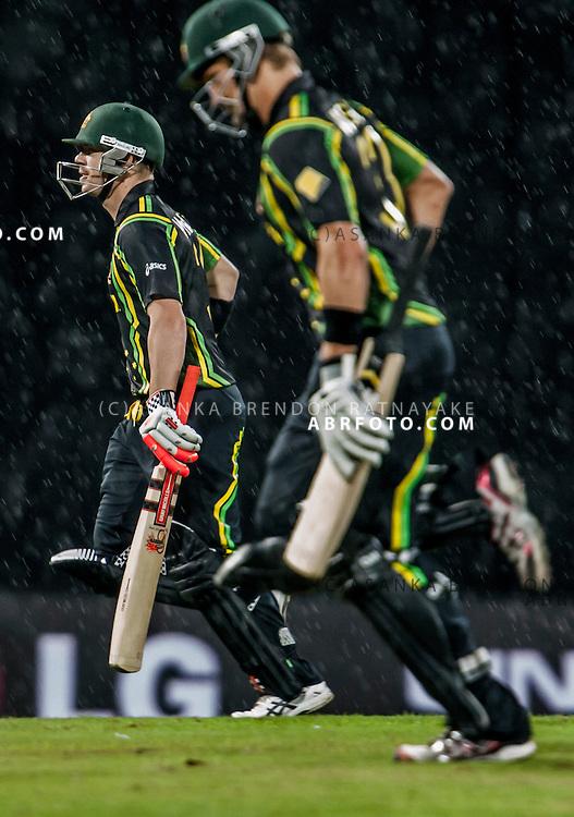 Australian players David warner and Shane Watson run off the field as its about to rain during the ICC world Twenty20 Cricket held in Sri Lanka.