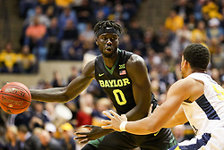 Jan 9, 2018; Morgantown, WV, USA; Baylor Bears forward Jo Lual-Acuil Jr. (0) passes the ball during the first half against the West Virginia Mountaineers at WVU Coliseum. Mandatory Credit: Ben Queen-USA TODAY Sports