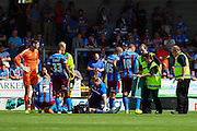 Luke Williams is assisted by medical staff during the Sky Bet League 1 match between Burton Albion and Scunthorpe United at the Pirelli Stadium, Burton upon Trent, England on 8 August 2015. Photo by Aaron Lupton.