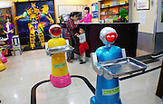 """HARBIN, CHINA - JUNE 07: (CHINA OUT) <br /> <br /> Two robot waiters deliver meals at Liu Hasheng Robot Restaurant on June 7, 2015 in Harbin, Heilongjiang province of China. A Haiying robot manufacturer in north China\'s Harbin Harbin Economic and Technological Development Zone has developed into a comprehensive company where multifunctional robots could be made out to work on the land, in water and air. Liu Hasheng, chief manager and founder of the robot manufacturer, opened the first conprehensive robots restaurant in China with \""""waiters\"""" produced by his own company. According to Liu Hasheng, those robot waiters have been sold out throught out country and his orders has also a great business opportunity in the future. <br /> ©Exclusivepix Media"""