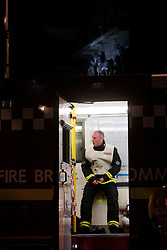 Anna Branthwaite, Camden, London<br /> 19/04/2014<br /> A fire fighter rests after attending to a fire that started inside the Stables at Camden Market. <br /> Photo: Anna Branthwaite/LNP