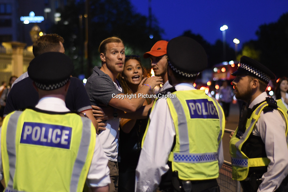 Police scuffles fans after England loss to Croatia the 2018 FIFA World Cup semi-finals in Moscow outside Hype park on 11 July 2018.