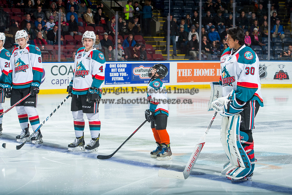 KELOWNA, CANADA - DECEMBER 30: The Pepsi Save On Foods player of the game lines up alongside Gordie Ballhorn #4  and Roman Basran #30 of the Kelowna Rockets against the Victoria Royals on December 30, 2017 at Prospera Place in Kelowna, British Columbia, Canada.  (Photo by Marissa Baecker/Shoot the Breeze)  *** Local Caption ***