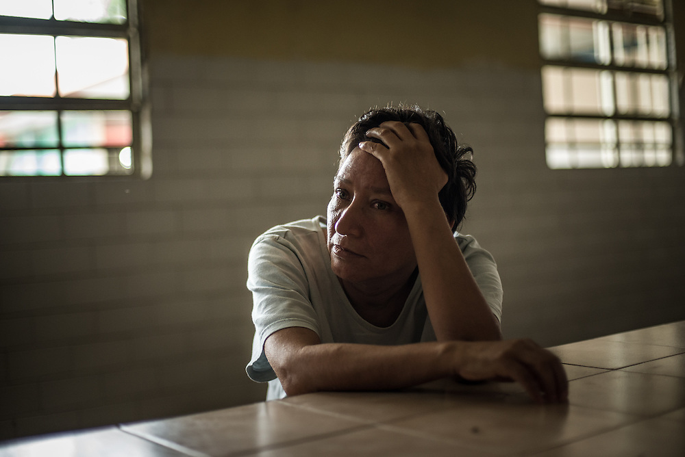 BARQUISIMETO, VENEZUELA - JULY 28, 2016:  Dementia patient, Rosa Querales waits for dinner to be served in the women's ward. She has lived at the hospital since 2008.  The economic crisis that has left Venezuela with little hard currency has also severely affected its public health system, crippling hospitals like El Pampero Psychiatric Hospital by leaving it without the resources it needs to take care of patients living there, the majority of whom have been abandoned by their families and rely completely on the state to meet their basic needs. The hospital has not employed a psychiatrist for over two years. The halls are filled with sounds of patients crying or screaming, and an overpowering stench of urine and feces.  Drugs used to combat bipolar disorder, epilepsy, schizoaffective disorder and chronic anxiety are now in short supply, as are numerous sedatives and tranquilizers needed to care for patients. Members of the nursing staff debate daily which patients are the most unstable, to decide which patients will receive pills and which will go without. When a patient loses control, often the only thing they can do is lock them in an isolation cell to prevent them from hurting themselves, other patients and members of the staff. The hospital does not even have basic hygiene or cleaning supplies.  There is no soap, no shampoo, no tooth paste, no toilet paper.  Patients relieve themselves in the common areas and patio area, and clean themselves only with water. Nearly every patient is infected with scabies because they do not have the resources to bathe properly or to have their threadbare, misfitted clothes washed as often as needed. To make matters worse, the hospital only has running water a few hours a day.  PHOTO: Meridith Kohut for The New York Times