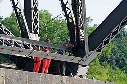 Performers relax during preparation of an aerial acrobatics show underneath the Strawberry Mansion Bridge over the Schuylkill River. (Bastiaan Slabbers/for PhillyVoice)