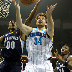 January 19, 2011; New Orleans, LA, USA; New Orleans Hornets center Aaron Gray (34) has the ball knocked away by Memphis Grizzlies power forward Darrell Arthur (0) during the first quarter at the New Orleans Arena.   Mandatory Credit: Derick E. Hingle