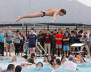 Junior Steven DeStefano dives into the pool following a ribbon-cutting ceremony for the new $4.5-million aquatic center at Adolfo Camarillo High School on February 18, 2014.