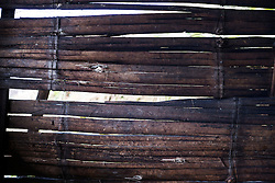 Laiza 20160915<br /> Holes in the bamboo wall after the Burmese army shellings of Tsin Yu Bum, a mountain top with a frontline outpost, near Laiza, Kachin State, Myanmar.<br /> Photo: Vilhelm Stokstad / Kontinent