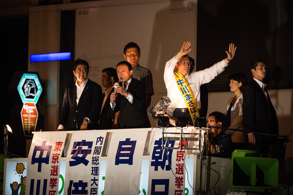 TOKYO, JAPAN - JULY 9 : Prime Minister Shinzo Abe (left), Kentaro Asahi (center back),  Masaharu Nakagawa (far right) and Tarō Asō (center) , the Liberal Democratic Party (LDP) Finance Minster, delivers a campaign speech to support their candidates during the last day of Upper House election campaign outside of Akihabara Station in Tokyo, Japan on July 9, 2016. Tomorrow, July 10, 2016 will be the first Upper house election nation-wide in Japan that 18 years old can vote after government law changes its voting age from 20 years old to 18 years old. (Photo by Richard Atrero de Guzman/NURPhoto)