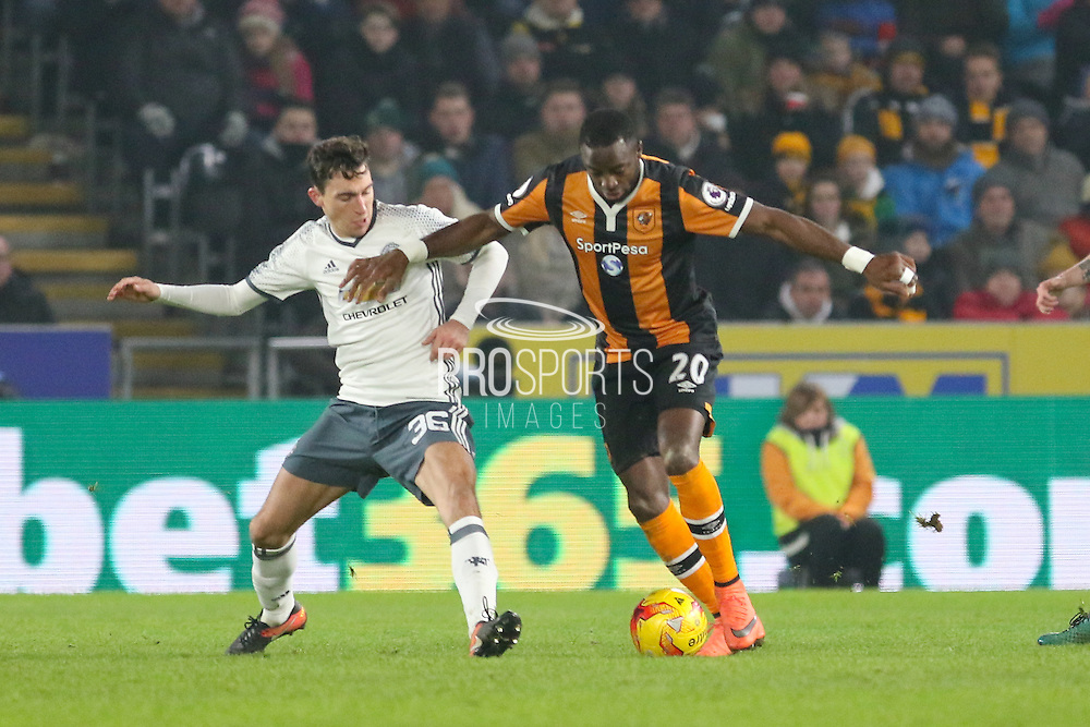 Hull City Forward Adama Diomande is tackled by Matteo Darmian Defender of Manchester United during the EFL Cup semi final match 2 between Hull City and Manchester United at the KCOM Stadium, Kingston upon Hull, England on 26 January 2017. Photo by Phil Duncan.