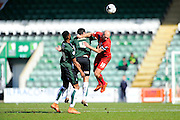 Plymouth Argyle's Carl McHugh and York City's Russell Penn compete to head the ball during the Sky Bet League 2 match between Plymouth Argyle and York City at Home Park, Plymouth, England on 28 March 2016. Photo by Graham Hunt.