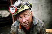 Gwyn Evans, 48, one of the miners working to restore Unity Mine is portrayed while having a break on the surface, on Friday, Apr. 13, 2007, in Cwmgwrach, Vale of Neath, South Wales. The time is ripe again for an unexpected revival of the coal industry in the Vale of Neath due to the increasing prize and diminishing reserves of oil and gas, the uncertainties of renewable energy sources, and the technological advancement in producing energy from coal while limiting emissions of pollutants, has created the basis for valuable investment opportunities and a possible alternative to the latest energy crisis. Unity Mine, in particular, has started a pioneering effort to revive the coal industry in the area, reopening after more than 8 years with the intent of exploiting the large resources still buried underground. Coal could be then answer to both, access to cheaper and paradoxically greener energy and a better and safer choice than nuclear energy as a major supply for the decades to come. It is estimated that coal reserves in Wales amount to over 250 million tonnes, or the equivalent of at least 50 years of energy supply, while the worldwide total coal could last for over 200 years as a viable resource compared to only a few decades of oil and natural gas.