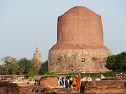 India, Uttar Pradesh. Sarnath temples. Dhamekh Stupa - where Siddhartha Gautama  taught for the first time after reaching enlightenment. Buddhist tourists from Thailand.