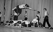 Jumping, diving over 5 students onstage for HS class