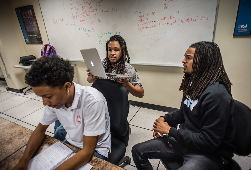 WASHINGTON, DC -- MARCH 31: From right: Howard students Khari Jackson, Victor Foreman and Siddiq Kancey get together in a Yahoo funded lab in the Engineering building to work on an app that they hope will be the next best thing. The students meet nearly everyday to move the project forward. Jackson is a TV&amp;Film major, Kancey is a Communication Information Systems major and Foreman is a Computer Science major. Foreman's graduation is delayed by one year due to a financial aid error by the university. They bring their combined talents to an app designed to connect people with events near them using geo-location.  <br /> Founded in 1867, Howard University is one of the elite HBCU's in the country, but revenue and administration problems plague the instititution and threaten its status. (photo by Andre Chung for The Washington Post)