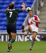 2005/06 Guinness Premiership Rugby, London Irish vs Bristol Rugby; Jason Strange , chip kick's the ball over Lieron Dawson's head.  Madejski Stadium, Reading, ENGLAND 24.09.2005   © Peter Spurrier/Intersport Images - email images@intersport-images..