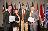 Jonathan Lehman of Lawton, Oklahoma, and Joshua Maples of Okemah, Oklahoma, receive an Oklahoma State University Oklahoma Soybean Board Scholarship from Rick and Ginger Reimer at the university's recent College of Agricultural Sciences and Natural Resources Scholarships and Awards Banquet. The scholarship is part of more than $1.4 million in scholarships and awards presented to CASNR students for the 2016-2017 academic year. (Photo by Todd Johnson)
