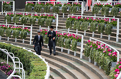© Licensed to London News Pictures. 19/06/2018. London, UK.  Racegoers in top hats walk around an empty parade circle while attending day one of Royal Ascot at Ascot racecourse in Berkshire, on June 19, 2018. The 5 day showcase event, which is one of the highlights of the racing calendar, has been held at the famous Berkshire course since 1711 and tradition is a hallmark of the meeting. Top hats and tails remain compulsory in parts of the course. Photo credit: Ben Cawthra/LNP