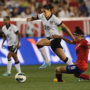 Carli Lloyd, USA, is challenged by Cho Sohyun, Korean Republic, during the U.S. Women Vs Korea Republic friendly soccer match at Red Bull Arena, Harrison, New Jersey. USA. 20th June 2013. Photo Tim Clayton