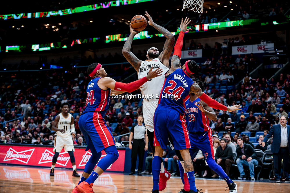 Jan 8, 2018; New Orleans, LA, USA; New Orleans Pelicans center DeMarcus Cousins (0) shoots over Detroit Pistons forward Tobias Harris (34) and forward Eric Moreland (24) and forward Reggie Bullock (25) during the second half at the Smoothie King Center. The Pelicans defeated the Pistons 112-109. Mandatory Credit: Derick E. Hingle-USA TODAY Sports