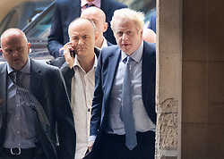 © Licensed to London News Pictures. 25/09/2019. London, UK. Prime Minister Boris Johnson arrives Parliament in Westminster with his special advisor Dominic Cummings after The Supreme Court in London yesterday ruled that Parliament had been suspended illegally. British Prime Minster Boris Johnson prorogued parliament just weeks before the UK is due to leave the EU on October 31st. Photo credit: Peter Macdiarmid/LNP