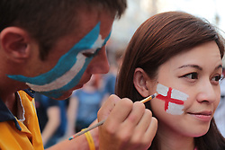 June 18, 2018 - Moscow, U.S. - MOSCOW, RUSSIA - JUNE 18: Fans of teams of different countries get their faces painted on Nikolskaya Street for the 2018 FIFA World Cup on June 18, 2018, in Moscow, Russia. (Photo by Anatoliy Medved/Icon Sportswire) (Credit Image: © Anatoliy Medved/Icon SMI via ZUMA Press)