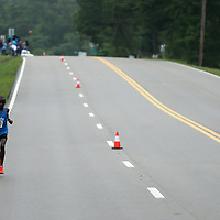 The lead runner runs alone on Front Street during the Gumtree Run Saturday morning in Tupelo.