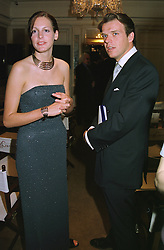 The HON.CAMILLA ASTOR daughter of Lord Astor of Hever and MR JOEL CADBURY, at a party in London on 18th May 1999.MSD 20