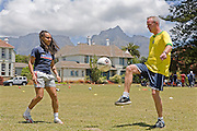 Norman Cook  and Hope Powell, warm up in football attire in South Africa where they are helping the charity, Coaching for Hope. The charity is an innovative programme, which uses football to create better futures for young people in West and Southern Africa.
