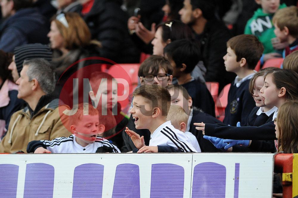 A young Bristol City fan enjoys the game - Photo mandatory by-line: Dougie Allward/JMP - Tel: Mobile: 07966 386802 01/03/2014 - SPORT - FOOTBALL - Bristol - Ashton Gate - Bristol City v Gillingham - Sky Bet League One