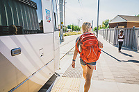 Kelly Halpin exits the streetcar in the Sugar House neighborhood of Salt Lake City, Utah.