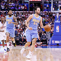 15 April 2014: Denver Nuggets guard Evan Fournier (94) brings the ball up court during the Los Angeles Clippers 117-105 victory over the Denver Nuggets at the Staples Center, Los Angeles, California, USA.