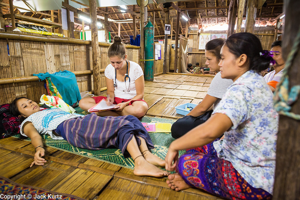 22 MAY 2013 - MAELA, TAK, THAILAND:   Dr. MARGAREET TRIP, a Dutch pediatrician, talks to a Burmese woman who is pregnant and has malaria in the SMRU Clinic in the Maela Refugee Camp. Health professionals are seeing increasing evidence of malaria resistant to artemisinin coming out of the jungles of Southeast Asia. Artemisinin has been the first choice for battling malaria in Southeast Asia for 20 years. In recent years though,  health care workers in Cambodia and Myanmar (Burma) are seeing signs that the malaria parasite is becoming resistant to artemisinin. Scientists who study malaria are concerned that history could repeat itself because chloroquine, an effective malaria treatment until the 1990s, first lost its effectiveness in Cambodia and Burma before spreading to Africa, which led to a spike in deaths there. Doctors at the Shaklo Malaria Research Unit (SMRU), which studies malaria along the Thai Burma border, are worried that artemisinin resistance is growing at a rapid pace. Dr. Aung Pyae Phyo, a Burmese physician at a SMRU clinic just a few meters from the Burmese border, said that in 2009, 90 percent of patients were cured with artemisinin, but in 2010, it dropped to about 70 percent and is now between 55 and 60 percent. He said the concern is that as it becomes more difficult to clear the malaria parasite from a patient, progress that has made been in combating malaria will be lost and the disease could make a comeback in Southeast Asia.     PHOTO BY JACK KURTZ