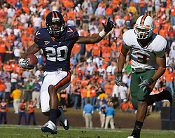 Virginia wide receiver Kevin Ogletree (20) rushes for a touchdown against Miami.  The Virginia Cavaliers faced the Miami Hurricanes in a NCAA football game at Scott Stadium on the Grounds of the University of Virginia in Charlottesville, VA on November 1, 2008.Miami defeated Virginia 24-17 in overtime.