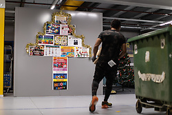 """© Licensed to London News Pictures . 04/12/2019. Manchester , UK . Staff activities posted on a wall inside the """"MAN1"""" Amazon fulfilment centre warehouse at Manchester Airport in the North West of England . Photo credit : Joel Goodman/LNP"""