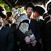 Members of the Jewish Community take part in a scroll reading ceremony in Stamford Hill, north London