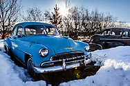 Two Antique Cars in Snow on the prairie, Alberta Canada