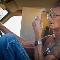 A mechanic takes a smoke break before starting the work day August 10, 2010, in Odessa, Texas.