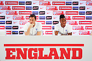 Frank Lampart (L) and Raheem Sterling (R) speak to the media during the England press conference at Est&aacute;dio Claudio Coutinho, Rio de Janeiro<br /> Picture by Andrew Tobin/Focus Images Ltd +44 7710 761829<br /> 17/06/2014
