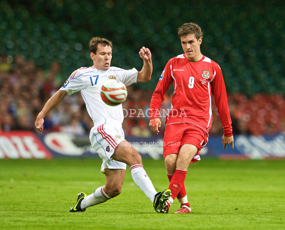 CARDIFF, WALES - Wednesday, September 9, 2009: Wales' Aaron Ramsey and Russia's Konstantin Zyryanov during the FIFA World Cup Qualifying Group 3 match at the Millennium Stadium. (Photo by Dave Kendall/Propaganda)