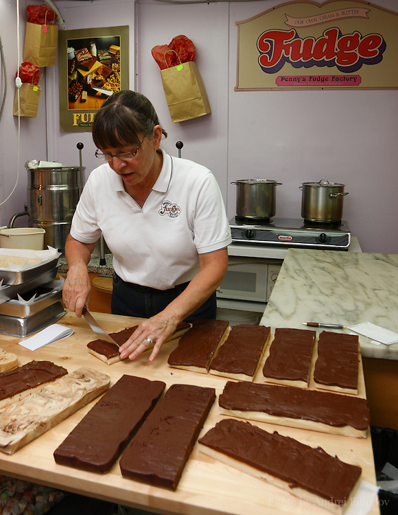 Judy Gravel, the owner of the Penny's Fudge Factory, cutting fudge slabs, August 9, 2009. Penny's Fudge Factory located in Fitzroy Harbour, ON, Canada, outside of Ottawa, the Capital of Canada. More info: http://www.pennysfudgefactory.ca.