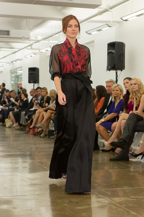 Black flare-legged trousers with red and black floral print top. By Carmen Marc Valvo at the Spring 2013 Fashion Week show in New York.