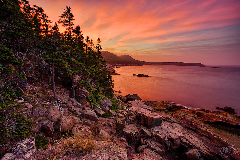 Perched atop Otter Cliffs in Acadia National Park watching the setting sun change the sky into a kaleidoscope of colors.
