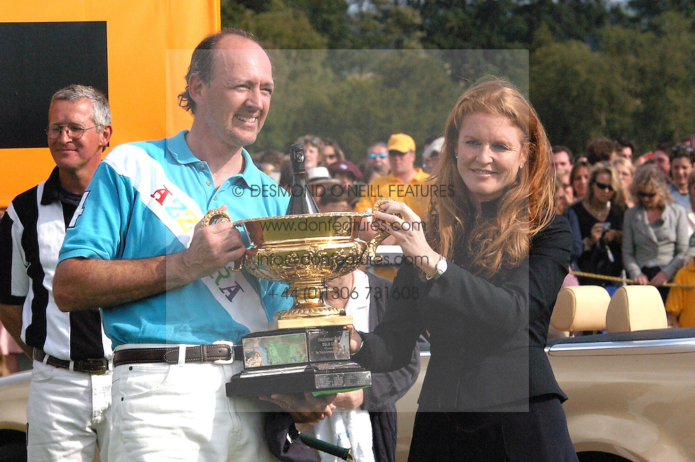 Azzurra's winning captaim STEFANO MARSAGLIA receives the Gold Cup from SARAH, DUCHESS OF YORK at the Veuve Clicquot sponsored Gold Cup or the British Open Polo Championship won by The  Azzurra polo team who beat The Dubai polo team 17-9 at Cowdray Park, West Sussex on 18th July 2004.