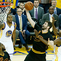 12 June 2017: Cleveland Cavaliers forward Kevin Love (0) goes for the layup past Golden State Warriors forward Kevin Durant (35) during the Golden State Warriors 129-120 victory over the Cleveland Cavaliers, in game 5 of the 2017 NBA Finals, at the Oracle Arena, Oakland, California, USA.