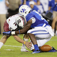 September 29, 2012 - Lexington, Kentucky, USA - South Carolina quarterback Connor Shaw losses the ball as he his hit by UK's Mikie Benton as the University of Kentucky plays South Carolina at Commonwealth Stadium. South Carolina won the game 38-17. (Credit Image: © David Stephenson/ZUMA Press).